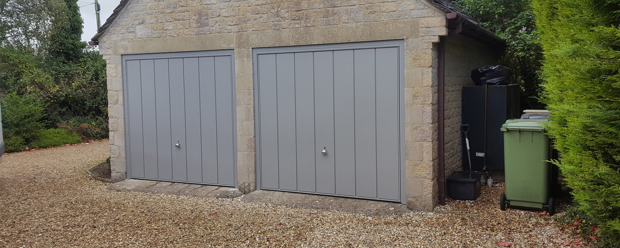 CANOPY/RETRACTABLE GARAGE DOORS